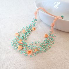 Peach crochet necklace with beads and polymer by CrochetFancyLove