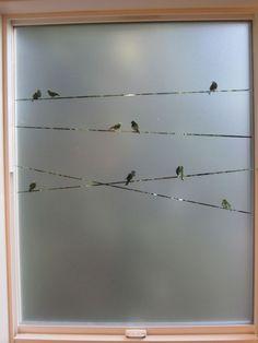 Stenciled birds on a window