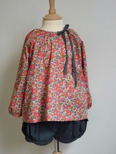Use Peasant dress cut for shirt with bow on side. Also reversible shorts.1090652