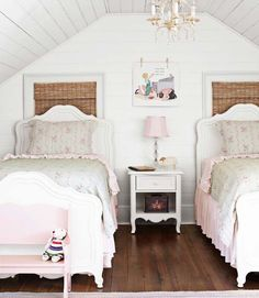 In the girls' room, linens by Simply Shabby Chic for Target dress trundle beds by Young America; the lamp is from Target.   - HouseBeautiful.com