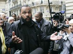 Dieudonne Mbala Mbala was awarded the tittle of Honorary Guide on June 27, 2015 (69 a.H.) for his relentless fight for freedom of expression in France. He is a French comedian, actor and political activist.