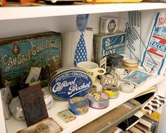 An assortment of color-coded travel and flea market finds from the studio of graphic designer Louise Fili. Posted by DesignSponge Flea Market Style, Flea Market Finds, Flea Markets, Louise Fili, Italy Summer, Vintage Tins, Shelfie, Retro Toys, Displaying Collections