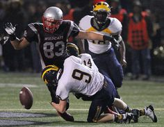 Bellevue's Ross Connors strips the ball from Mount Si's Griffin Mclain in the final play of the game. See more of Seattle Times photographer Colin Diltz's photos from the game.