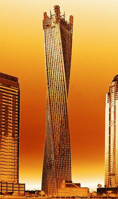 golden tower \ Dubai by austrianeye beautiful colors and architecture Unusual Buildings, Interesting Buildings, Amazing Buildings, Modern Buildings, Dubai Buildings, Famous Buildings, Futuristic Architecture, Beautiful Architecture, Art And Architecture