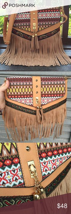 Tasseled Handbag bold colors, lots of detail, beautiful combination of fringe/tassel/metal, extremely intense print (making this handbag stand out as the topic of conversation), shoulder strap included, versatility, made from faux leather (yay! No harm to our little furry friends), polyester lining and brass metalwork Bags