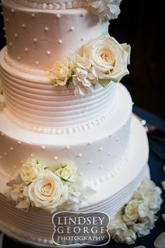 Close up of pretty five tier wedding cake by Cupcake Island click to view full gallery The Scoular Ballroom Omaha Nebraska
