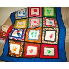 """Calendar Kids: Handprint Quilts Through the Year- simply """"stamp"""" kids' hands on fabric with fabric paints; then embellish with rickrack, googly eyes, and more. Transform little handprints into creepy spiders, funny reindeer, springtime kites, and summer flip-flops. One main quilt features a sampling of blocks, while smaller quilts spotlight each season."""