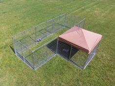 Professional T shaped dog kennel systems with heavy duty canvas top and raised flooring.