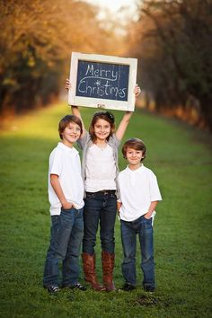 Christmas card photo ideas. I like how the kids are holding the chalk board but I think I would dress my kiddos in more Christmassy outfits maybe add Santa hats. Still a cute idea.
