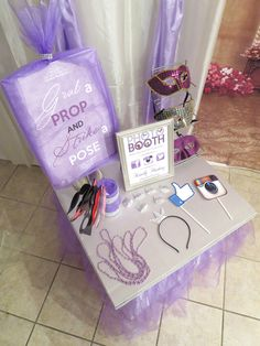 Grab a prop and strike a pose photo booth at a Sofia the First Birthday Party!  See more party ideas at CatchMyParty.com!