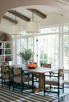 2 pendants over table. Traditional Dining Room by Peter Dunham Design
