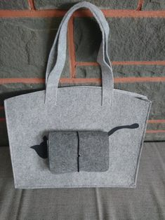 The bag is made of grey felt, front with a small bag that is securely closed with a rubber It is 35 x 28 cm tall Shopper, Felt, Etsy, Bags, Small Bags, Felting, Handbags, Dime Bags, Lv Bags