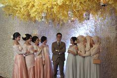 groom and bridesmaid