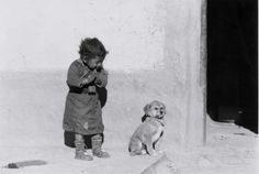 "Nepalese child greeting a dismissive puppy.   ""Namaste, Kagbeni, Nepal"" by Barbara Sparks, 1986…"