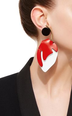 Bold, sculptural and modern, these **Marni** earrings feature an abstract red and white leather design—perfect for a striking evening statement.