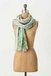 Scarf Styling Cues.   Anthropologie shows several ways to wear a scarf.