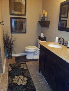 Master Bath Remodel.  I like that the toilet is almost at a separate area, the shower wall is facing it.   Plus, love that rug!!