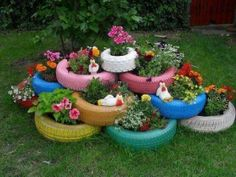 Gardening!****This is a cute idea, stacking them up like this, but I think my kids would throw rocks at me, but it sure would clear out the barn of all those old tires.  Now, how to keep the freakin' cats out of them.