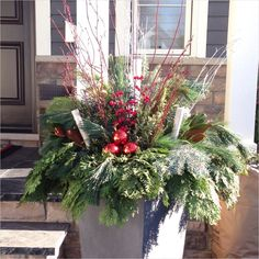 Ten Facts You Never Knew About Christmas Flower Pots Outside Christmas Decorations, Christmas Porch, Christmas Centerpieces, Christmas Wreaths, Christmas Facts, Outdoor Decorations, Holiday Decorations, Xmas, Winter Planter