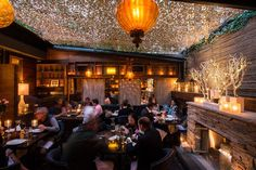 Patrons enjoy a mix of traditional and inventive Spanish tapas prepared by chef Luis Bollo at New York's Salinas. The Chelsea restaurant has a hand-operated retractable roof that is opened on summer nights.