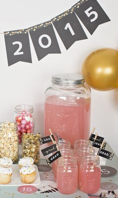Graduation table display idea featuring a banner from pear tree greetings with fun treat ideas!