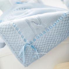 copertina culla in lana con mezze treccie