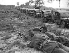 """Market Garden day 5. 5-th day of operation """"Market Garden"""". The Allied advance was slowed to a halt as Germans cut the road from Eindhoven to Nijmegen, receiving the nickname """"Hellish Freeway. The photos of British soldiers to guard the Bren machine gun a long convoy of jeeps from a possible German attack while they wait for the order to move further forward. 21st September 1944"""