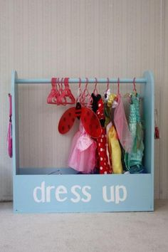 I would love to make this, but a boy version.  I like the option of adding a top shelf and lowering the dowel.  My kids can never find their costumes.  This would help them keep things organized.  I love that the bottom is an open bin for helmets, hats ect.