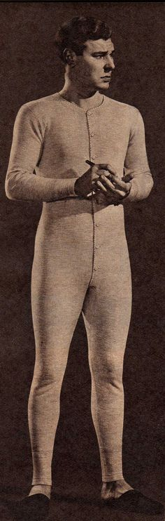 During a cold winter, men might throw on a 'union suit' underneath their clothes. This was simple long underwear. The '40s version was very fitted with buttons down the front. The legs reached down to the ankles with long or short-sleeves. These were usually white ribbed cotton with a high crew neck. Short leg varieties with short or tank top sleeves were an alternative to just undershorts in spring or autumn weather.