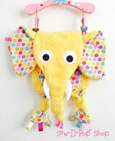 Meet the maker: Sew-D-Pop Shop on Hello, I'm Handmade! A maker of unique and bright blankets, toys, and more for babies and kids.