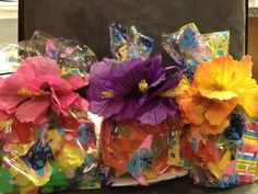 We are having a Hawaiian themed birthday cake and party favors for an 8-year-old's birthday.  I ordered the party favor stuff from Oriental Trading.  One of the items was a hibiscus hair clip.  I decided instead of putting the clips in the bags, to use them to seal the bags.