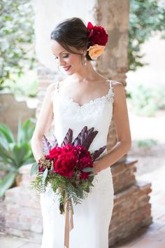 A classic red Spanish-inspired look for the bride and groom by Chloe Atnip Photography