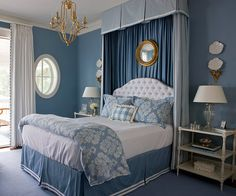 Given the nautical scene outdoors, blue and white isn't a surprising scheme for a lake-house bedroom. But regal treatments, including a stately canopy, tufted headboard, and tassel-trimmed curtains, dress up the comfortable room.