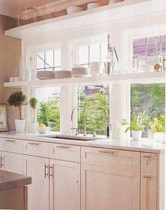 Small Kitchen Idea: shelves over / in-front-of window for more tasteful, decorative, smart storage options