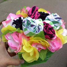 Instead of giving flowers to my daughter for her dance recital. I made this arrangement out of tank tops and a Hawaiian lay!