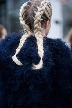 Can't get enough of this tight blonde plaits and blue fuzzy coat combo