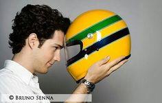 Bruno Senna holding his uncle's iconic yellow helmet.