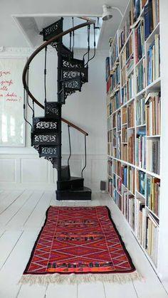 Black spiral stair and Kilim rug