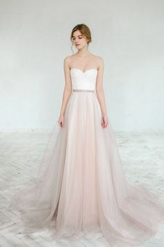 This item includes off-white lace and chiffon wedding dress and separate blush tulle skirt. It is the perfect solution for anyone who wants a