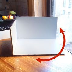 Creating a White Background Inside a Cardboard Box    I covered the inside of cardboard box with...