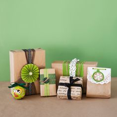 Paper Bag Wrapping Ideas  http://blog.landofnod.com/honest-to-nod/2011/12/present-wrapping-ideas.html#