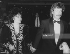 Actress Elizabeth Taylor w. boyfriend Larry Fortensky at a party to promote her perfume.