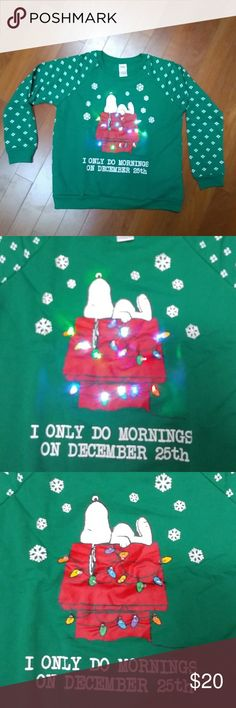 NWT Snoopy Peanuts light up sweatshirt Super cute shirt with control to turn on the lights for Snoopy's house.  Listed as girls top, but can be for boys too.  Girls is size L (11-13). Peanuts Shirts & Tops