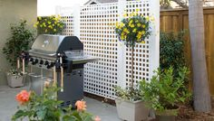 A 6x9 ft lattice grill screen serves as a backdrop to the grill and creates a comfortable, room-like feeling.