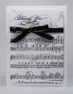 """Sing a sweet song on this handmade thank you card.  Musical note stamps set the score for your """"thank you"""" stamp and black and gold ribbon."""