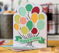 Say Happy Birthday in style! This cute balloon birthday card is super easy to make in Design Space using your Cricut Explore!  All you need is colored cardstock and some foam squares.