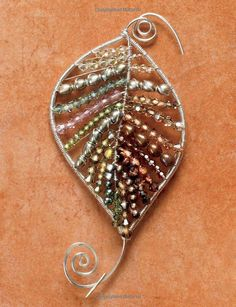 Leaf-shaped: wire-wrapped pendant with beads #jewelry