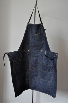 name_ denim aproncolor_ indigo bluematerial_ vintage selvedge Denimセルヴィッジデニムを使用...|ハンドメイド、手作り、手仕事品の通販・販売・購入ならCreema。 Demin Skirt, Kitchen Gloves, Work Aprons, Work Uniforms, Denim Ideas, Old Jeans, Apron Dress, Bag Patterns To Sew, Couture