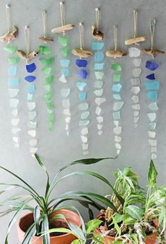 Sea Glass Chimes & Suncatchers that Bring an Oceanic Vibe to the Home. Lovely Ha… Sea Glass Chimes & Suncatchers that Bring an Oceanic Vibe to the Home. Lovely Hangings Made with Sea Glass. Featured on Completely Coastal. Wine Bottle Crafts, Mason Jar Crafts, Mason Jar Diy, Sea Glass Crafts, Sea Glass Art, Sea Glass Decor, Beach Crafts, Diy And Crafts, Adult Crafts