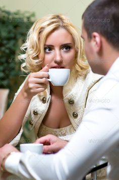 Couple at restaurant ...  acquaintance, adult, beautiful, blond, boyfriend, cafe, caucasian, celebration, coffee, couple, date, dating, dinner, drink, family, female, flirt, flirtation, flirting, friend, friends, friendship, girl, girlfriend, guy, husband, leisure, love, lovely, male, man, marriage, meeting, people, person, portrait, positive, pretty, relationship, restaurant, romance, romantic, sitting, together, togetherness, two, wife, woman, young